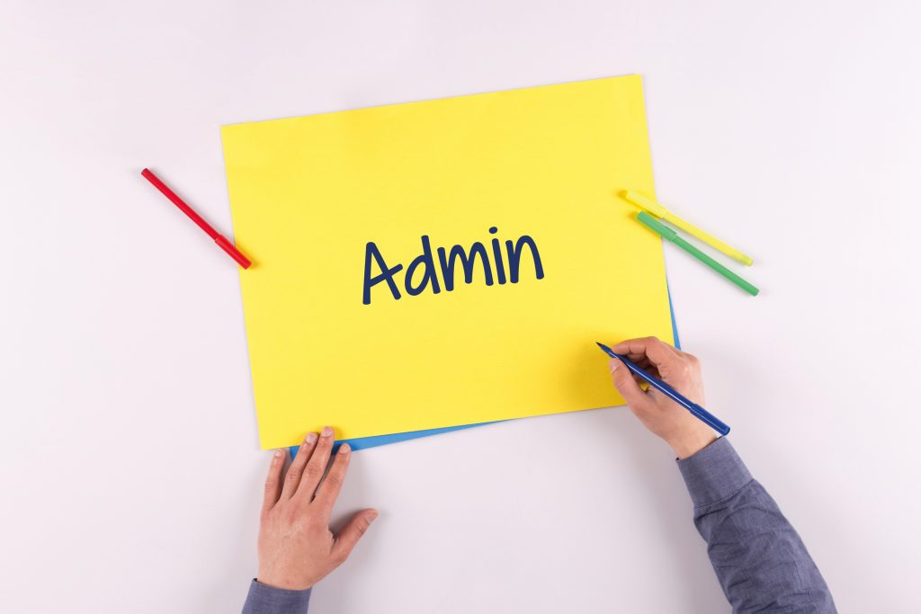 Hand writing Admin on yellow paper